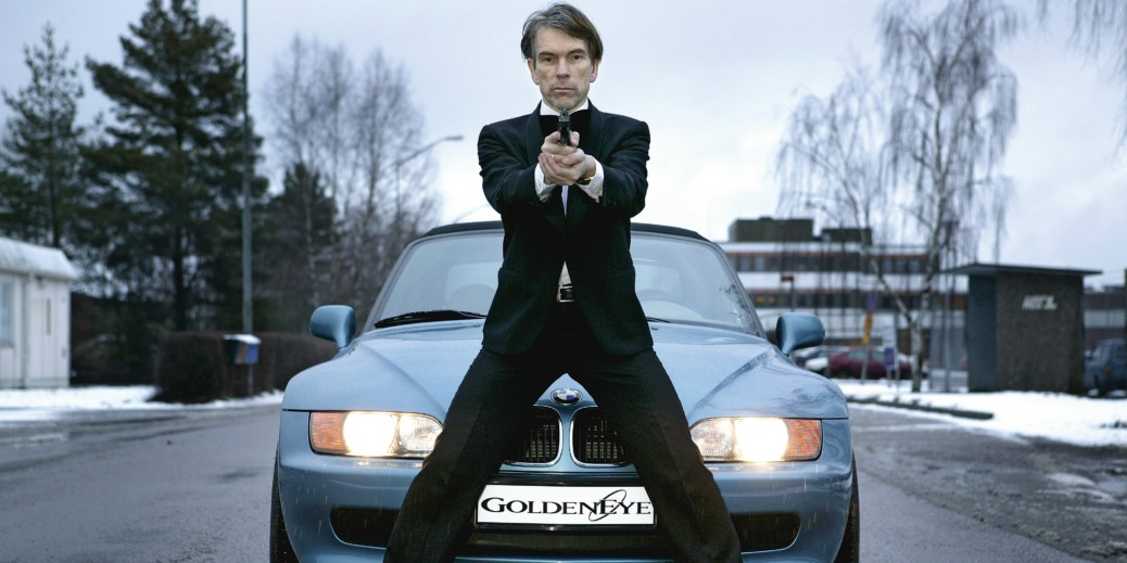 James Bond Gunnar Schäfer, founder of the only James Bond Museum - standing in front of a Bond car