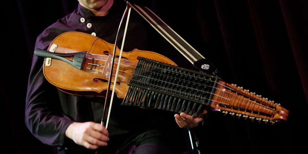 Man playing the Nyckelharpa