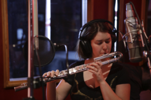 Elsa Nilsson plays flute for a radio show